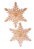 Two Golden Snowflakes Stock Images
