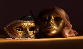 Two golden Venetian masks Stock Image