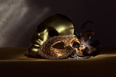 Two golden Venetian masks Royalty Free Stock Photo