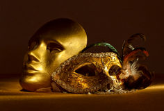 Two golden Venetian masks Royalty Free Stock Photos