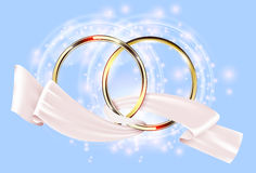 Two golden wedding ring with white ribbon Royalty Free Stock Photos