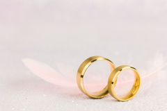 Free Two Golden Wedding Rings And Light Angel Feather Stock Images - 91196864
