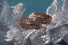 Two golden wedding rings Stock Images