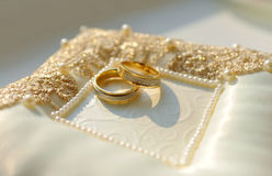 Two golden wedding rings with diamonds Royalty Free Stock Photos