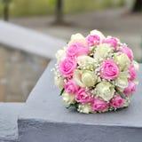 Two Golden Wedding Rings on flowers. Macro shot Royalty Free Stock Photos