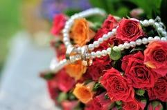 Two Golden Wedding Rings on flowers. Macro shot Royalty Free Stock Image