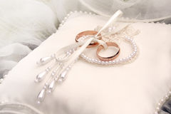 Two golden wedding rings on silk. Stock Photo