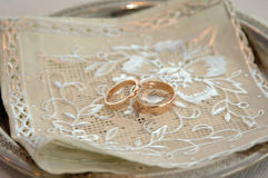 Two Golden Wedding Rings on table macro shot Royalty Free Stock Image