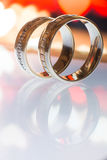 Two golden wedding rings on a tablet. Two golden wedding rings on a PC tablet Royalty Free Stock Photo