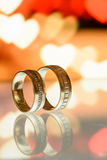 Two golden wedding rings on a tablet. Two golden wedding rings on a PC tablet Stock Image