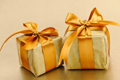 Two golden wrapped gift boxes Royalty Free Stock Image