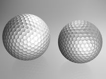 Two golf balls Stock Images