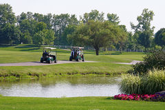Two Golf Carts. Driving on the Golf Course Royalty Free Stock Photos