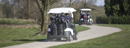 Two golf carts. Two plain golf carts Stock Photography