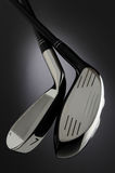Two Golf Clubs on Dark Background Stock Images
