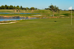 Two Golf holes. Holes next to water in golf course Stock Photos