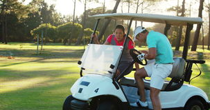 Two golf players getting into golf buggy. At golf course 4k stock video footage