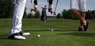 Two golf players and jumping women. Stock Image