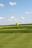 Two golf yellow flag Stock Photos