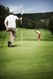 Two golfer on green Royalty Free Stock Images