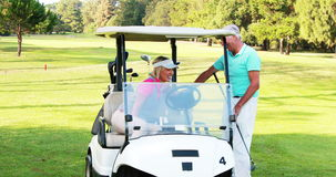 Two golfer players interacting with each other stock footage