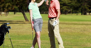 Two golfer players playing golf together stock video footage