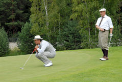 Two Golfers at Country Club. MOSCOW - JULY 05: Two John Doe on a traditional tournament on a golf in style retro  at VI Moscow's Festival Retrostyle taken place Stock Images