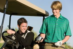 Two golfers by golf cart royalty free stock image