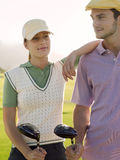 Two Golfers On Golf Course Royalty Free Stock Photo