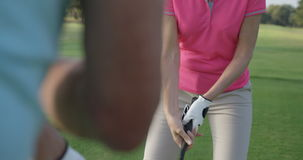Two golfers playing golf together. At golf course stock video footage