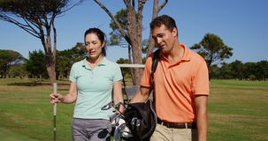 Two golfers walking together with golf bag stock footage
