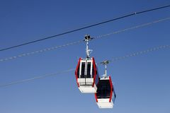 Two gondola lifts close-up view Royalty Free Stock Images