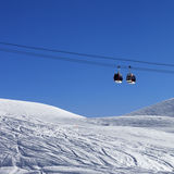 Two gondola lifts at ski resort Stock Photos