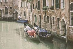 Two gondola in Venice canal, vintage style stock photography