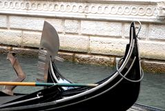 Two gondolas cross in a canal in Venice Stock Images