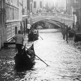 Two gondolas with gondoliers in Venice, Italy. Black and white picture of two gondolas in Venice, Italy Stock Photos