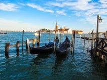 Two gondolas in the sea on the background of San Giorgio Maggiore. Bright colorful photo.  Beautiful Venice Stock Photos