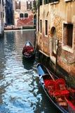 Two gondolas in Venice. Two empty gondolas on a chanel in Venice, Italy Royalty Free Stock Photos