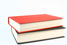 Two Good Books Isolated On White. Two old books stacked on a white background, one red and one black Stock Photos