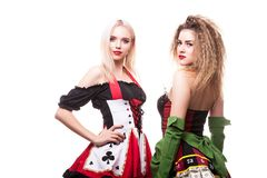 Two gorgeous entertainer girls in casino type outfit over white. Background in studio photo. Chance and risk. Gambling and winning Royalty Free Stock Images