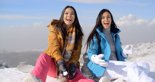 Two gorgeous laughing young woman in snow Stock Photo