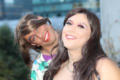 Two gorgeous transgender women outdoors stock image