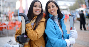 Two gorgeous young brunette snowboarders Royalty Free Stock Images