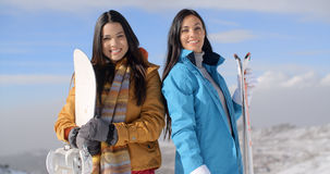 Two gorgeous young women posing with snowboards Royalty Free Stock Image