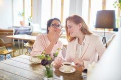 Two Gossipers Having Coffee Break Stock Photos