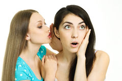 Two gossiping girls royalty free stock images