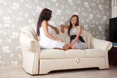 Two gossips women Royalty Free Stock Image