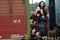 Two gothic girls on a train royalty free stock photo