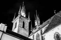 Two gothic towers of Church Of Our Lady Before Tyn at Old Town Square by night. Prague, Czech Republic. Black and white image stock photo