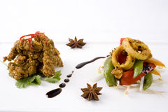 Two Gourmet Starters. Crispy Sesame Beef and Thai Squid Salad Royalty Free Stock Photo